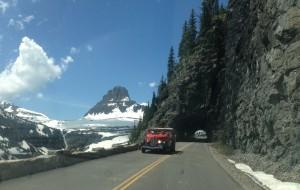 Stop #6: Passing through the tunnel just below Logan Pass, we saw one of the park's iconic red buses.