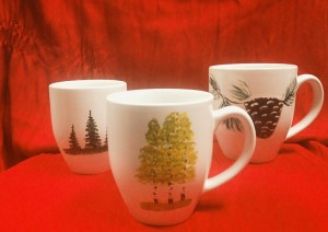 Hand-painted mugs by Montana artist Randy McIntyre.