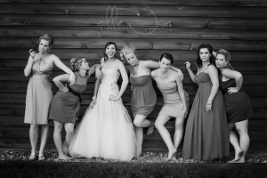 "Striking our best ""Bridesmaids"" pose at a perfect summer wedding."