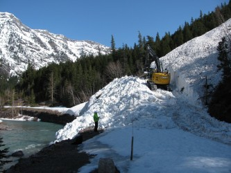 Clearing slide debris on April 16.  Photo courtesy: GlacierNPS
